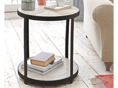Little Sunshine is a lovely round side table made from reclaimed elm with gorgeous gunmetal detail. It also has a handy bottom shelf for extra storage.