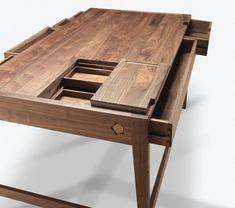While there may not be any glue or screws in this French Oak desk designed by Bruno Serrao for Wewood, what the desk does have is tonnes of storage....