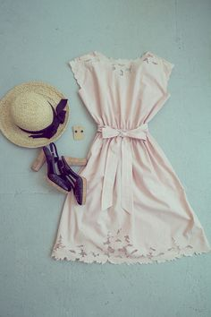Peach vintage cotton dress, cork heeled sandals, a vintage hat, and metal rose studs by Love, Seyi.