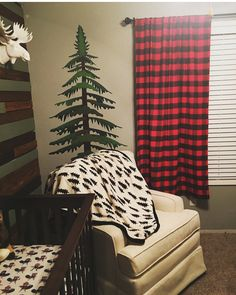 Lumberjack nursery, nursing area with moose head and pine tree decal. Homemade Buffalo plaid curtains