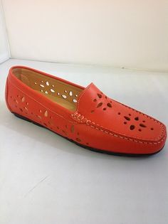 Clarus from Italy.  Mocassin style with perforated design.  Available in Mango and White.    Sizes range 36.5 - 41.