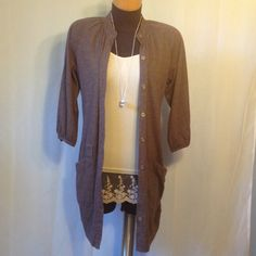 Free People Cardigan. Pockets on front. Has loops for a small belt or cord. Buttons up in the front. Pre loved. Free People Sweaters Cardigans