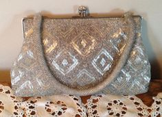 Silver Beaded Evening Bag, Clutch, Diamond Beaded Purse, Silver Framed Clutch, Silver Handbag by DartmouthHill on Etsy https://www.etsy.com/listing/262759258/silver-beaded-evening-bag-clutch-diamond