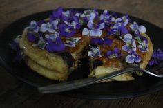 Blue berry pancakes with edible wild violets