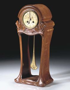 Maurice Dufrène (French 1876-1955) Table Clock,  Mahogany and Gilt Bronze. (Enlarge)