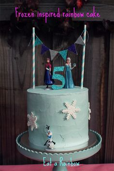 Frozen themed 6 layer rainbow cake with Anna, Elsa, Olaf, snowflakes and glitter bunting. Diy Cake Topper, Frozen Cake Topper, Cake Toppers, Easy Frozen Cake, Twin Birthday Cakes, 5th Birthday, Frozen Themed Birthday Party, Frozen Party, Cake Decorating Shop