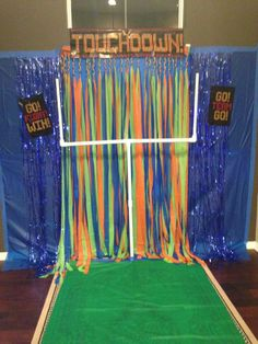 """My friend and I just made this for our #Superbowl party on Sunday! This was made with 3 $1.99 (Party City) table cloths that we stapled together at the top and then braided together after cutting.  The goal post is made from 1"""" pvc pipe from Home Depot. Easy, cheap, and it will be a great hit for the party!   I'm pairing it with my MacBook Pro *Photobooth* and these Seahawks and Broncos prop cut-outs from """"Old Market"""" on Etsy!   #football #superbowlsunday #easy #broncos #seahawks #party"""