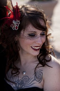 Octopus and feather veil. Love the idea of the pin and feathers.