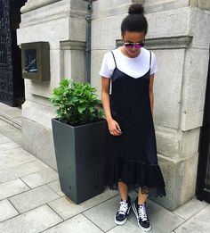 A lot of our favorite old trends came back in style this summer, but if any of them screams '90s the most, it might be the shirt under a dress look. Growing up, I watched all of the *cool kids* and older celebrities pull off silky slip dresses over plain white tees flawlessly, looking messy in an impossibly chic way. I layered my own dresses over shirts and tanks, but I was young, and didn't look nearly as cool as I wanted to.