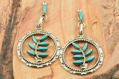 Genuine Sleeping Beauty Turquoise set in Sterling Silver Post Earrings. Beautiful Petit Point Design. The Sleeping Beauty Turquoise mine is located in Gila County, Arizona. Created by Zuni Artist Floyd Estate. The Zuni Pueblo is located in New Mexico, Land of Enchantment.
