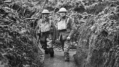 Two soldiers in flooded trench