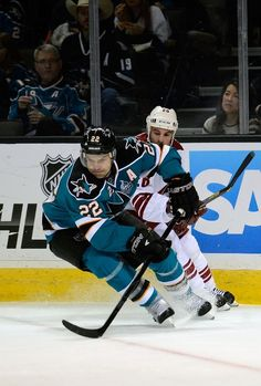 Dan Boyle  22 of the San Jose Sharks gains control of the puck in front e0f54a53f