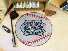 "The North Carolina Tar Heels Baseball Mat is a 26"" diameter baseball shaped area rug featuring the Tar Heel NCAA logo, made in the USA"