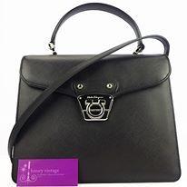 Model : S Ferragamo Tote, Material : Leather, Hardware : Silver, Color : Black, Measurement : L 10 X H 8 X W 2 inches, Condition : Good.