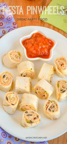 Fiesta pinwheels are make ahead appetizers and a great finger food. Flavorful, seasoned cream cheese cream is spread on tortillas and cut into pinwheels.