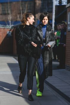 The Best Street Style At LFW AW16 #refinery29  http://www.refinery29.uk/2016/02/103500/street-style-london-fashion-week-aw16-news#slide-14  Junior Fashion Editor at GARAGE magazine Tati Cotliar steps out in neon green adidas 3-stripe trackies and matching plimsolls....