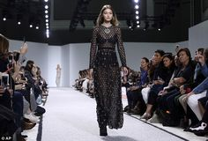 Prowling prowess: The model managed to steal the show with both her walks in the show...