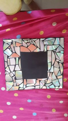 A frame made out of CDs ! :'D