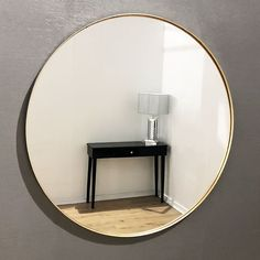 This modern large round gold framed arden wall mirror is a must have accent for any contemporary styled home. The smooth round frame is enhanced further by a subtle touch of gold adding to the elegance and charm.