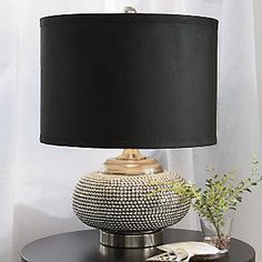 10 Stylish Ways to Update a Lamp, shown here using plumbing chain to update this lamp base, several other great ideas-