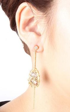 Caught In A Bind Earrings $60 - Oops, we are caught - caught up with how special this pair of earrings is. Look out for the intricate details of stone and metal in this fabulous asymmetrical piece.