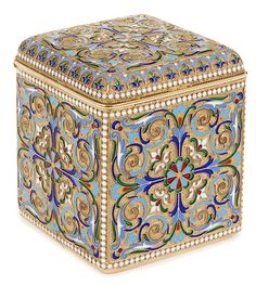 A LARGE AND IMPRESSIVE RUSSIAN SILVER GILT AND CLOISONNE ENAMEL TEA CADDY, MOSCOW 1899-1908. The sides and hinged lid similarly enameled with scrolling foliage and strapwork against a stippled gilt ground and with white enameled beading. The hinged lid opening to reveal a brightly gilded interior. Hallmarked Moscow 1899-1908, Cyrillic maker's mark for Lubavin under the Imperial Warrant and 88 silver standard. - Jackson's International Auctioneers and Appraisers