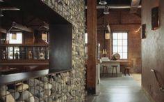 Thin gabion wall- between kitchen and living room?  Around backyard patio?