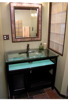 This Interior Cinnamon Colored Gl Block Window Provides Light To The Decorative Top Pedestal Sink
