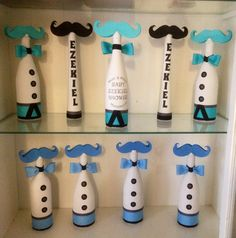 Centerpieces for my cousins babyshower! Lil Man Stache Theme. Upcycled wine bottles, you can leave by themselves or add flowers. Oh' Boy!! Bow Tie, Buttons, Blue & Teal & White.