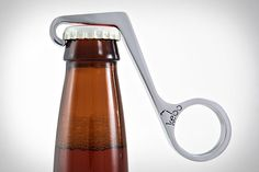 Based on the Theodore Low bottle opener from the '30s, it's cast from stainless steel, polished to a mirror finish, and allows you to open bottles with a simple squeeze of your hand
