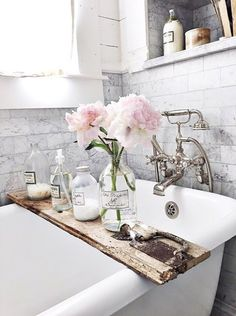cool bath shelf, rustic piece of wood across roll top bath. Very French Country