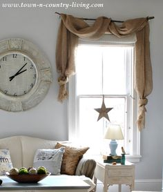 Landscape Burlap Curtain Swags via Town and Country Living - do these instead of the full burlap curtain??? DECISIONS DECISIONS