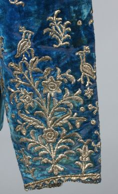 Sleeve detail of velvet Iranian jacket, embroidered with silver metal depicting Peacocks, birds, flowers and scrolls