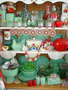 Jadeite, hens on nests, tulip bowl, covered fridge dishes, green depression reamer, and doilies.