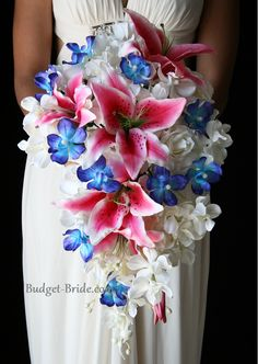 Stargazer Lilies, White and Blue Dendrobium Orchids, Good idea for centerpieces & bouquet.. I would switch the blue flower for either blue hydrangeas or maybe even blue & white forget-me-nots for a lighter blue..
