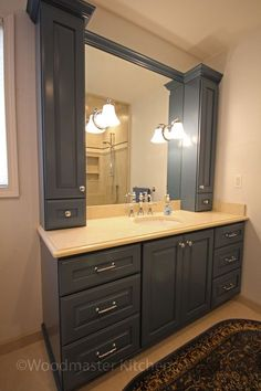 A traditional bathroom design offers practical storage combined with warm elegance. The large shower includes an Infinity shower trough drain, a corne. 20 Framed Bathroom Mirror Ideas for Double Vanity & Single Sink with light, Bathroom Mirror Makeover, Bathroom Mirror Cabinet, Small Bathroom Vanities, Large Bathrooms, Mirror Cabinets, Vanity Bathroom, Bathroom Makeovers, Bathroom Ideas, Bathroom Storage