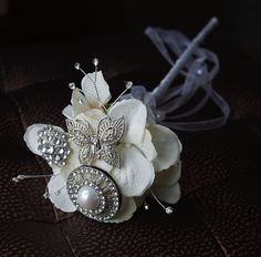 Bling Jewel Flower Girl Magic Wand made with silk hydrangea flowers and large brooch jewels. from www.wedideas.com