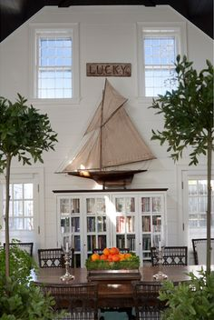 :: SUSAN ZISES GREEN :: Love the giant sailboat as decor for a two story wall