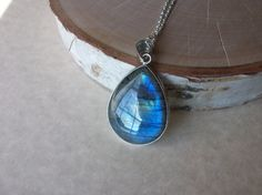 This is a beautiful all natural genuine large labradorite pendant on an open…