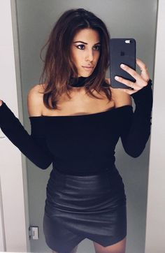 Black faux leather mini skirt with wrap front worn with off the shoulder top and choker.. DIY the look yourself: http://mjtrends.com/pins.php?name=black-faux-leather-fabric-for-skirt_1
