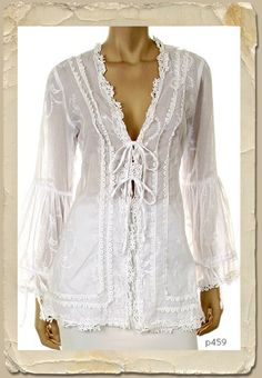 ...Totally!  p459 Out of Africa  Gorgeous gauze cotton jacket with beautiful embroidery . Tie fron with flowing bell sleeves . The back has a corset style design. 78.00