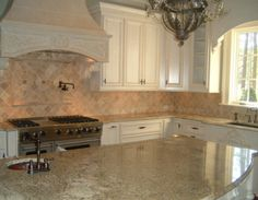 Our layout exactly.  Love the pot filler over stove.  Arched island top.