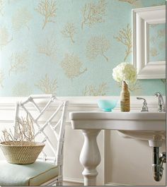 A coastal bathroom with coral wallpaper ~ gorgeous!