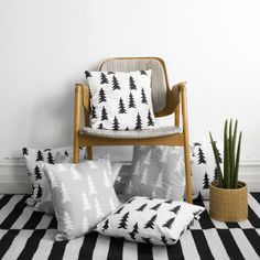 GRAN BLACK screen printed pillow              Screen printed pillow case with black firs on white base   A pattern in clean, modern, Scandinavian style