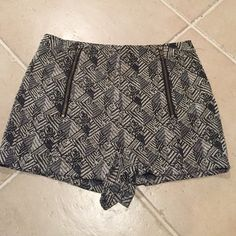 Black & white dressy shorts Worn once in like new condition. Rayon & polyester. Two zip closures in front. Two back pockets. Size 10, Fits true to size. Purchased from Urban Outfitters. Looks great with stockings or tights for the cold weather approaching. Price is negotiable. Urban Outfitters Shorts