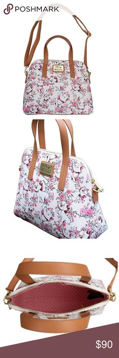 New Loungefly Disney's Aristocats Marie purse New with tags faux leather printed Marie from Disney's Aristocats floral handbag. Made by Loungefly. Zipper closure. Crossbody strap is removable . Such a pretty kitty Disney Bags Satchels