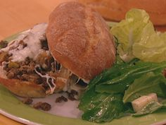 Rachael Ray's Philly Cheesesteak Sloppy Joes -----------------Becky's notes: Made it with ground chuck instead of sirloin, used regular buns, didn't make the salad. Tasted great! I wonder though if the sauce was necessary, next time might try with just a slice of provolone instead of the sauce, because the meat definitely ends up tasting like Philly meat.