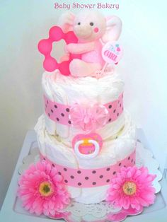 This adorable pink elephant diaper cake would make a cute baby shower centerpiece
