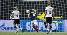 Germany's goalkeeper Nadine Angerer (1) is unable to stop a shot for a goal by France's Louisa Necib, not shown, as Germany's Leonie Maier (4) and Simone Laudehr (6) and France's Eugenie Le Sommer look on during the second half of a FIFA Women's World Cup quarterfinal soccer game, Friday, June 26, 2015, in Montreal, Canada. (Graham Hughes/The Canadian Press via AP) MANDATORY CREDIT