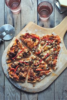 Thin crust pizza with caramelized onions, sausage (get inspired and change it if you need too), roasted red peppers.